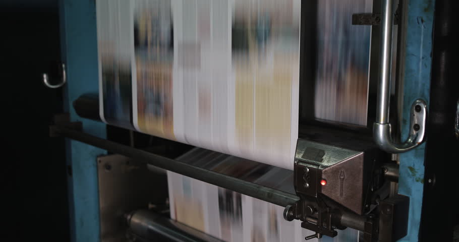 Print plant factory. Newspaper printing at a plant. Newspaper printed on a printing house machine | Shutterstock HD Video #1023829528