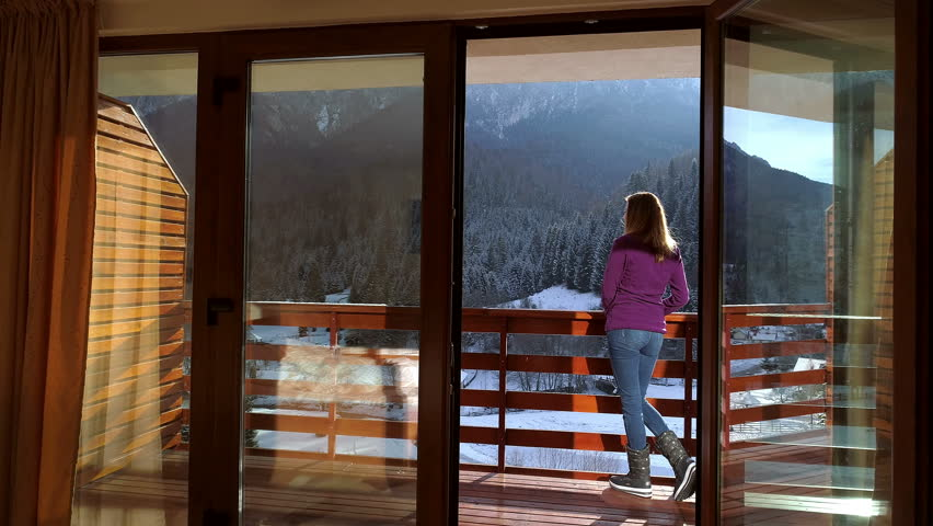 Young woman relaxing in a mountain chalet in winter time