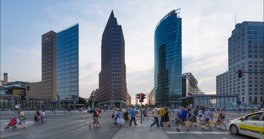 Day to night timelapse transition of Potsdamer Platz and traffic. Berlin, Germany - August 08, 2015