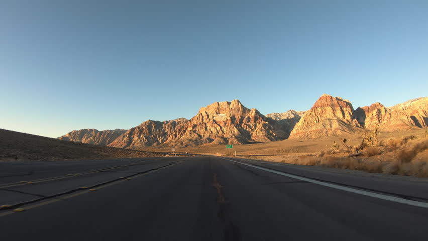 Early morning driving view of highway route 159 near Red Rock Canyon National Conservation Area and Las Vegas in Southern Nevada. | Shutterstock HD Video #1023988838