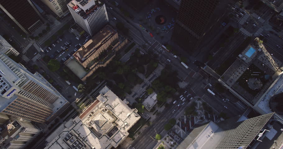 Epic helicopter wide shot POV AERIAL view of downtown los angeles cityscape and Aon center near LA Live showing cars driving through the city streets of California in the United States