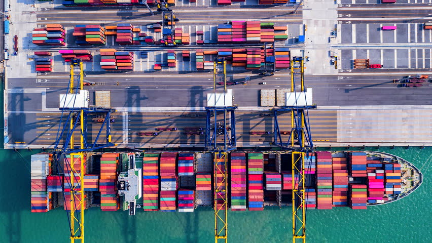 4K Timelapse of modern industrial port with containers from top view or aerial view. It is an import and export cargo port where is a part of shipping dock | Shutterstock HD Video #1024152968