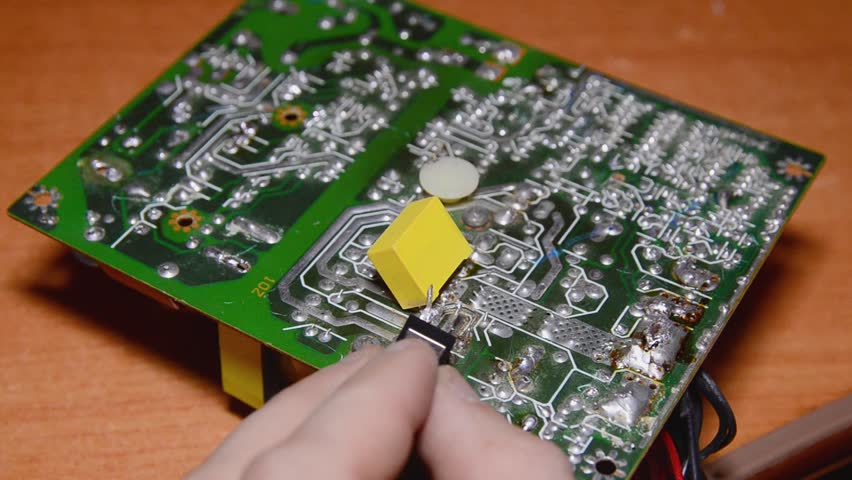 Repair of electronic devices, soldering parts. The master solders, repairs the board. solder wires | Shutterstock HD Video #1024155278