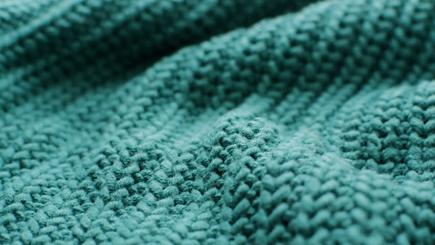 The texture of the fabric. Green knitted texture. Close-up. Can be used as a background. HD | Shutterstock HD Video #1024189838