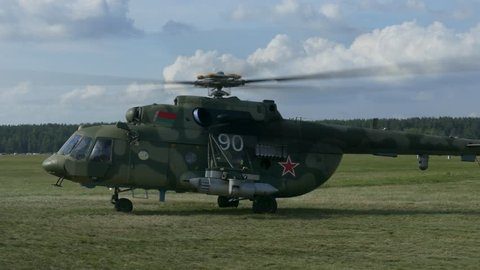Minsk, Belarus - Jul 28, 2018 (Ungraded): Military helicopter with symbols of the Air Force of the Republic of Belarus is preparing for takeoff. Ungraded H.264 from camera without re-encoding.