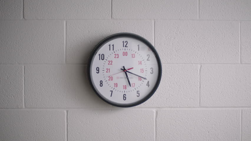 Large clock in high school hallway classroom.    Shutterstock HD Video #1024315118