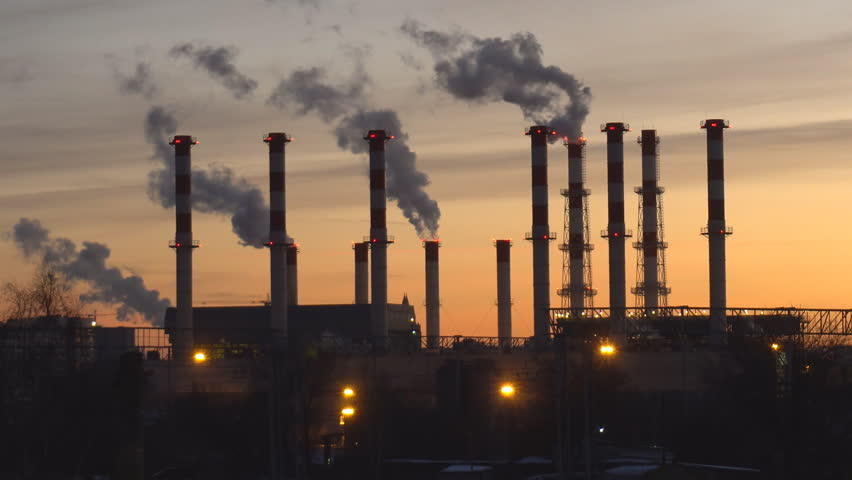Industrial landscape, the pipes of the thermal power plant at sunset