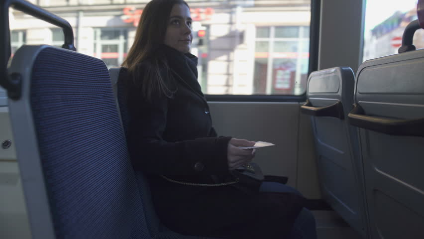 Bus conductor scanning female passenger ticket, public transportation, travel | Shutterstock HD Video #1024359518