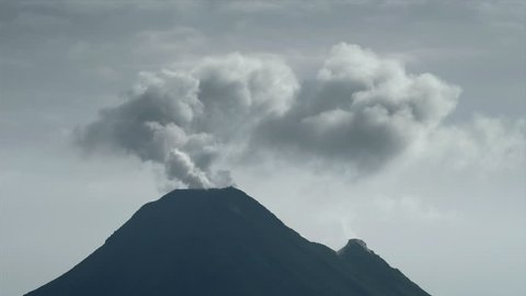 Volcano Arenal smokes in the air. Costa Rica