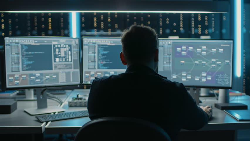 Professional IT Programer Working in Data Center on Desktop Computer with Three Displays, Doing Development of Software and Hardware. Displays Show Blockchain, Data Network Architecture. 8K RED