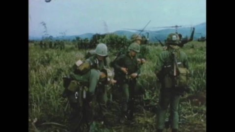 CIRCA 1966 - A group of soldiers are re-located and set up camp in a new location in Vietnam during the Vietnam War