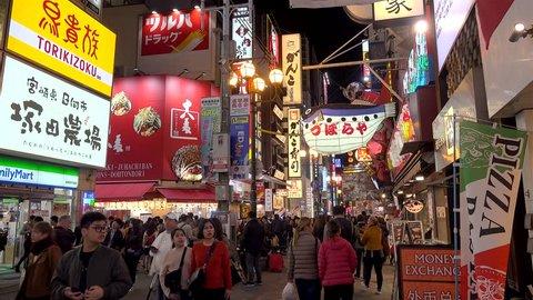 OSAKA,  NAMBA / JAPAN - NOVEMBER 4, 2018: Crowd at the Dotonbori street near Kani Doraku Crab & Golden Dragon Ramen  restaurants by night.