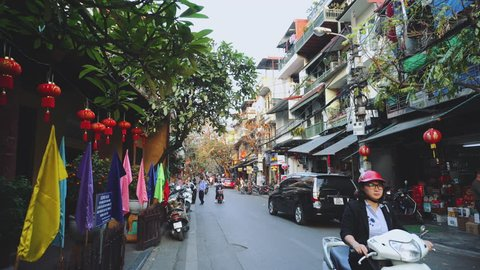 Hanoi, Vietnam - FEBRUARY 15, 2019: Motorcycle Traffic Pass Through Old Town, Hanoi Vietnam 4K