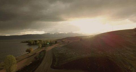 Mesmerizing beautiful sunset over Ennis Lake at Bear Trap Canyon Montana landscape at golden hour (drone shot)