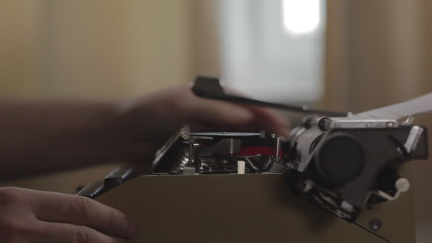 A man types text on an old typewriter. Typing a film script or a book on a vintage typewriter | Shutterstock HD Video #1024705778