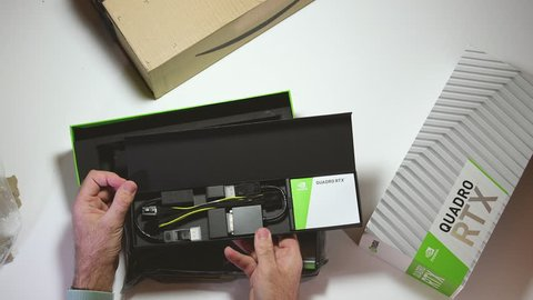 Paris, France - Feb 20, 2019: Time lapse fast motion unboxing of the latest Nvidia Quadro RTX 5000 workstation professional video card GPU for CAD CGI scientific calculations and machine learning