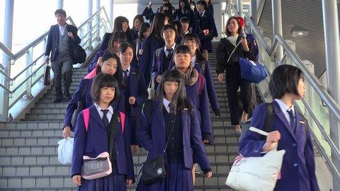 HIROSHIMA / JAPAN - NOVEMBER 2, 2018: Goup of Japanese schoolgirls coming down the stairs at the Hiroshima train station.