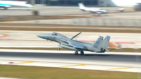 FORT LAUDERDALE, FL - 2019: F15 Combat Jet from the 125th Florida Air National Guard Fighter Wing Landing at FLL Hollywood International Airport on a Sunny Day in South Florida
