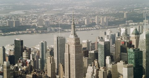 New York, NY, USA Circa 2018: Aerial view of Manhattan skyine Empire State Building in New York during the day under blue skies. Wide shot on 4K RED camera.