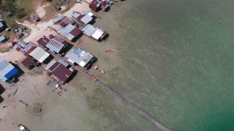 Beautiful Drone 4k footage of beautiful rural beach landscape with Beautiful white sandy beach with turquoise sea water and palm trees at Kuala Abai, Kota Belud, Sabah, Borneo