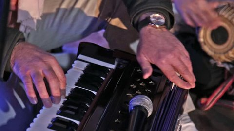 Hare Krishna Man Playing Traditional Indian Instrument Harmonium Close-up.