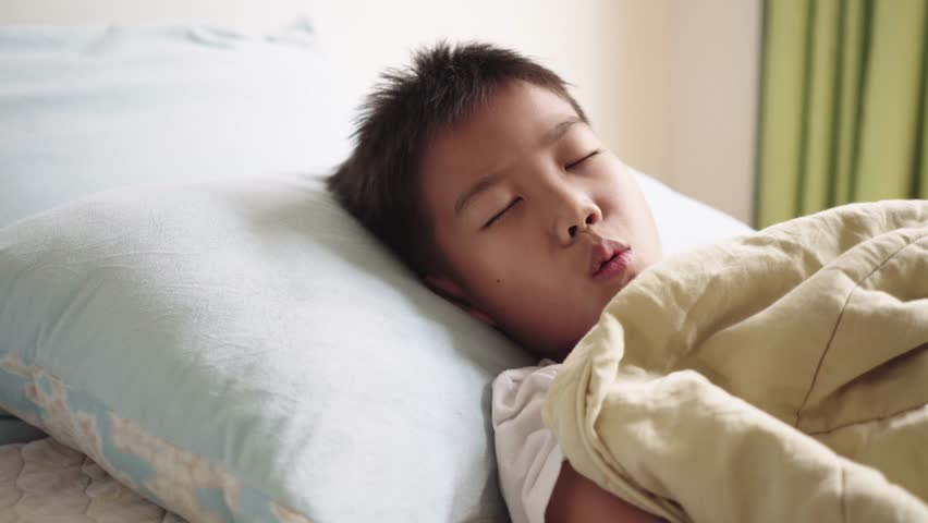 4k Young boy sick and sleep on a bed taking care by his mom in a bedroom.   Shutterstock HD Video #1025004248
