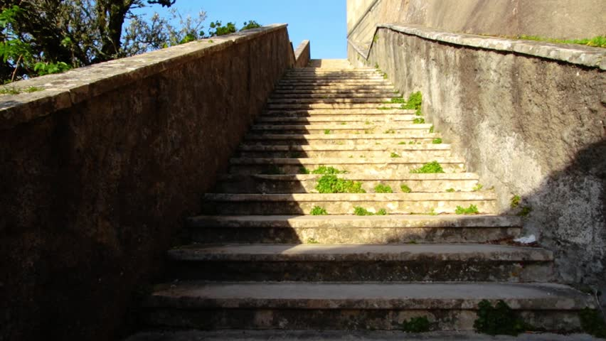 Climbing old stone stairs outside. POV. Glide shot, first person view camera climb up antique steps. Stone surface covered by moss. | Shutterstock HD Video #1025018408