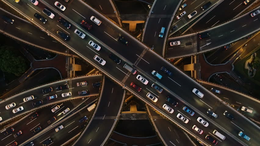 Rising drone shot reveals spectacular elevated highway and convergence of roads, bridges, viaducts in Shanghai at night, transportation and infrastructure development in urban China | Shutterstock HD Video #1025077628