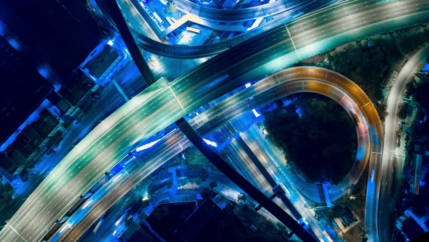 Hyper Time Lapse of Aerial View of Busy Highway Road Junctions at Night from a drone. The Intersecting Freeway Road Overpass The Eastern Outer Ring Road. | Shutterstock HD Video #1025109128