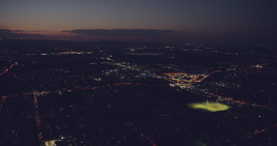 Aerial illuminated night view of city landscape community Shopping Centre sports ground suburbs residential homes Gold coast Queensland Australia | Shutterstock HD Video #1025142518