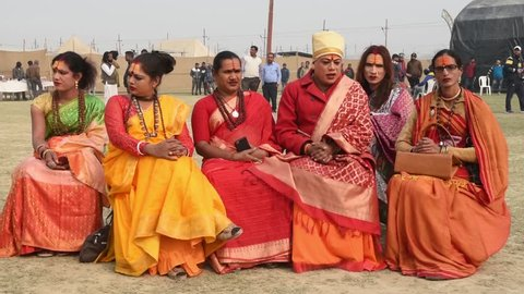 Allahabad / India 14 January 2019 Group of holy sadhu Hijra or third gender sitting on chairs at Prayagraj Kumbh Mela in Allahabad Uttar Pradesh India