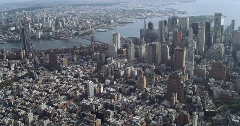 Aerial view of Manhattan skyine skyscrapers in New York during the day under blue skies. Wide shot on 4K RED camera.