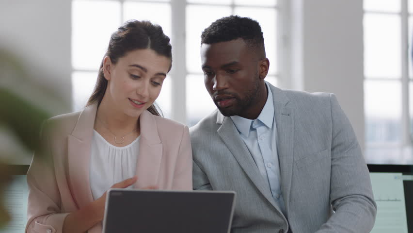 Business meeting team leader woman brainstorming with businessman colleague using laptop computer showing ideas pointing at screen working together in office | Shutterstock HD Video #1025211758