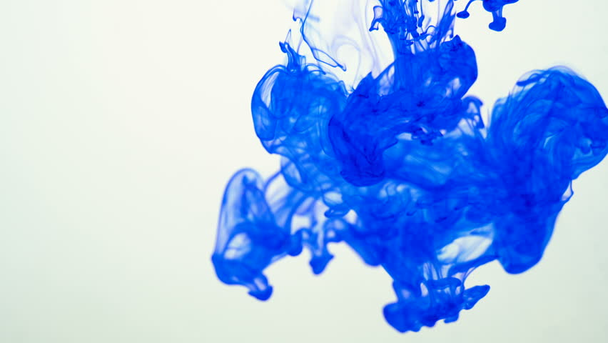 Blue color paint ink drops in water slow motion 3k video  with copy space. Inky cloud swirling flowing underwater. Abstract isolated smoke explosion