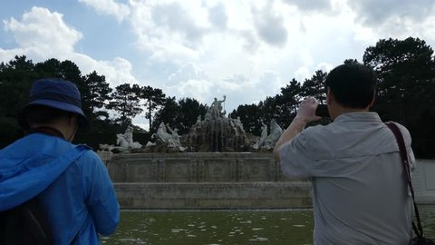 Vienna, Austria, - May 2018: The Neptune Fountain in Schonbrunn Park. Tourists walk in the park near the Neptune Fountain near the Schonbrunn Palace.