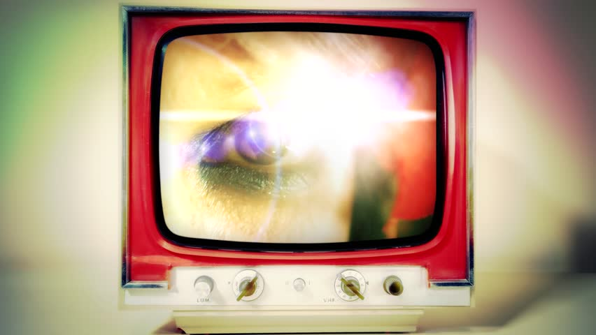 A retro vintage TV showing: a woman's eye with a strong lens flare, macro shot.  | Shutterstock HD Video #1025401358