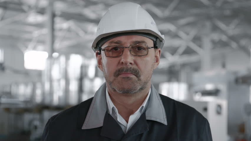 Engineer Planning Manufacture Work. Male Labor Person in Hardhat or Protective Clothes Closeup. Attractive Face of Older Caucasian Technical Foreman. Confident Workman Technician of Machine Tool Line | Shutterstock HD Video #1025420348