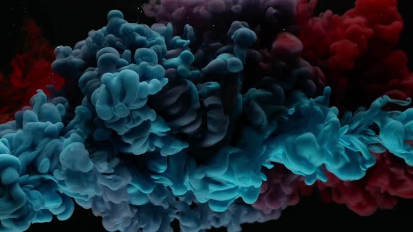 Super slow motion of coloured inks in water. Isolated on black background. Filmed on high speed cinema camera.  #1025434208