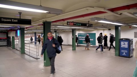 NEW YORK CITY - DECEMBER 3, 2018: Tourists and locals walk inside subway station hub. The city attracts 50 million people annually.