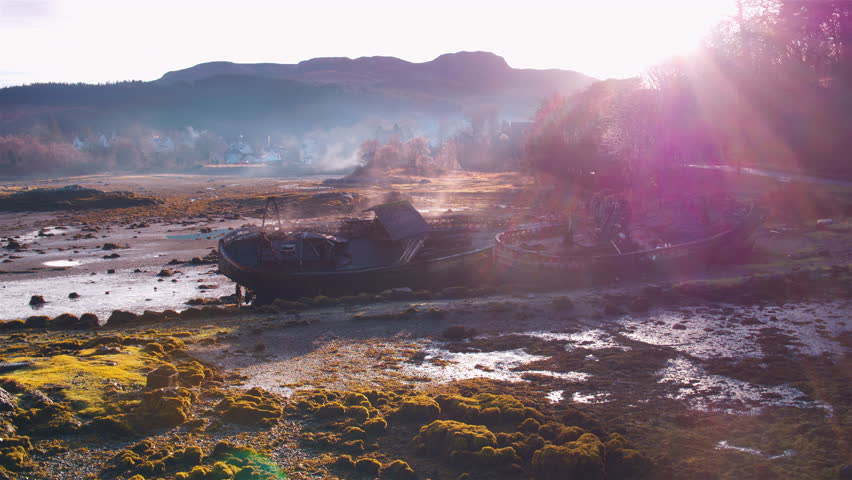 Absolutely stunning cinematic shot of wrecked boats steaming in morning sunshine   Shutterstock HD Video #1025449808