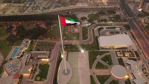 Aerial view of the United Arab Emirates Flag. Reveal shot downwards.
