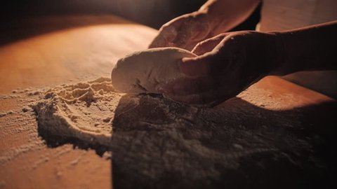 Women's hands sculpted dough pie. Close-up beautiful. Slow motion. Food supply.