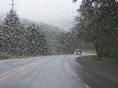 Rainy road and log truck