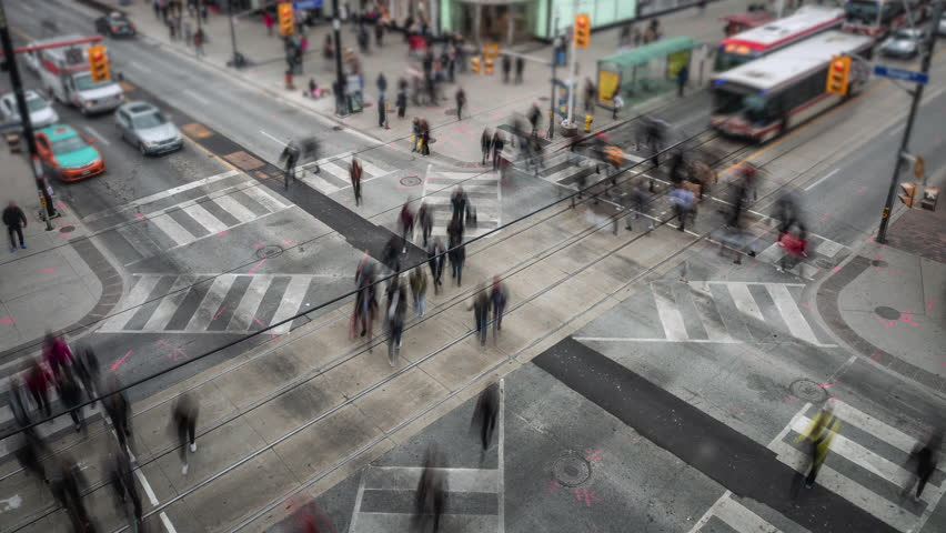 Toronto, Canada, time lapse view of traffic and pedestrians crossing busy intersection at Yonge and Dundas Square in downtown Toronto.