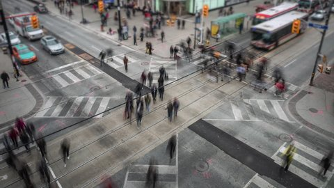 Time lapse view of people and traffic crossing busy intersection at Yonge and Dundas Square in Toronto, Ontario, Canada.