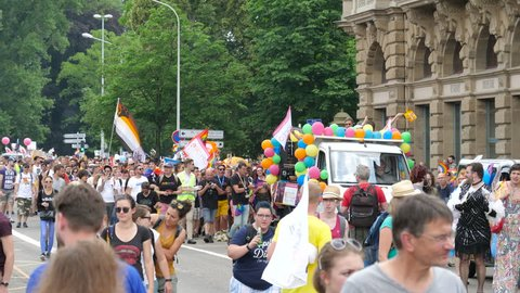 STRASBOURG, FRANCE - CIRCA 2018: People marching gathering near gay truck techno music at pride gays and lesbians parade marching French streets dancing fun party atmosphere
