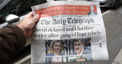 Paris, France - Mar 15, 2019: Brexit delayed until further notice after gang of four rebels the Daily Telegraph title man buy press