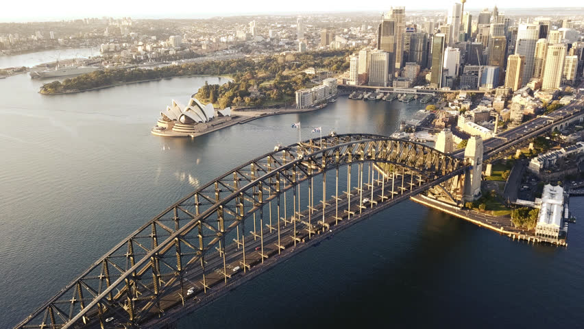 4k aerial cinematic drone footage b-roll of Sydney Harbour Bridge during sunrise.