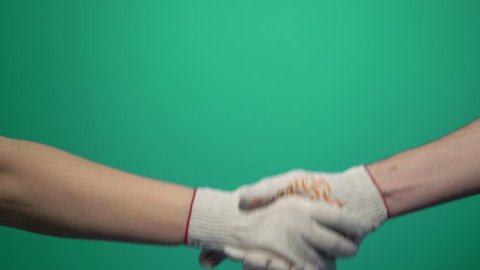 Handshake, shaking hands, handshaking. Two handed gesture. Chromakey. Green Screen Isolated business concept