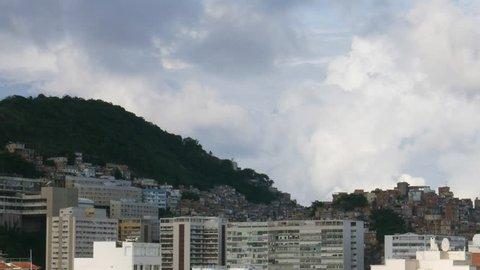 Timelapse of dramatic cumulus clouds above Cantagalo / Pavao Pavaozinho favela near Ipanema, Rio de Janeiro, Brazil - 4K